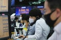 Asian shares fall despite fresh records on Wall Street