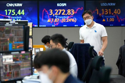 Asian shares mostly rise as markets digest Fed moves