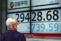 Asian shares sink after tech rout pulls Nasdaq 3.5% lower