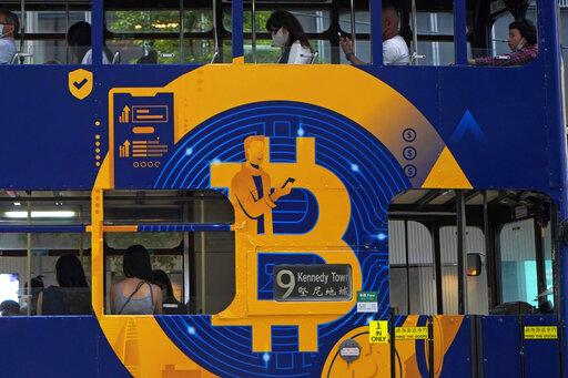 Bitcoin tops $66,000, sets record as crypto goes mainstream