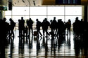 Image for Business travel stirs, but many road warriors stay grounded