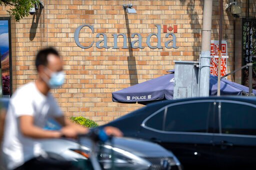 Canadian faces spy ruling as Huawei decision looms