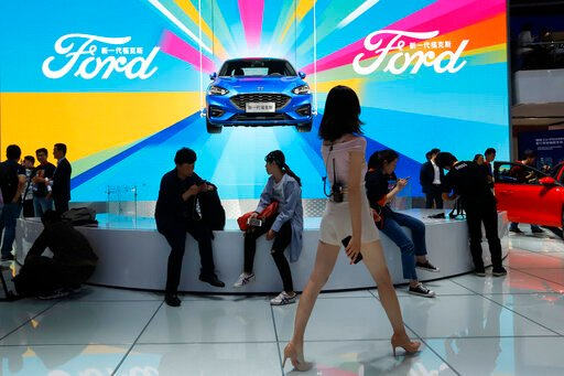 China delays tariffs on US autos, other goods in trade deal
