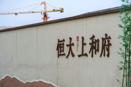 EXPLAINER: Chinese builder's debt struggle rattles investors