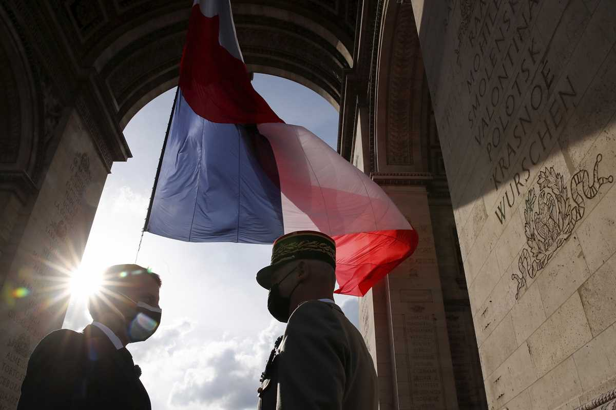 Ceremony to mark the end of World War II at the Arc de Triomphe in Paris