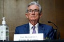 Fed sees earlier time frame for rate hikes with inflation up