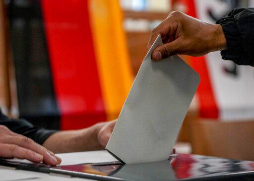 German vote nearly even for Merkel's bloc, Social Democrats