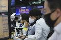 Global shares fall despite fresh records on Wall Street