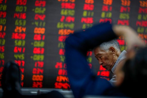 Global shares mixed after solid earnings push Wall St higher