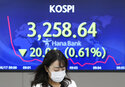 Global stocks lower after Fed moves up rate hike forecast