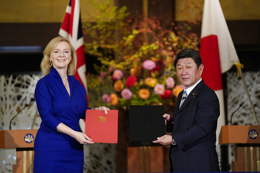Japan, Britain sign free trade deal for post-Brexit era