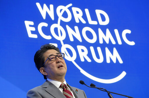 Leaders including Merkel and Abe take to main Davos stage