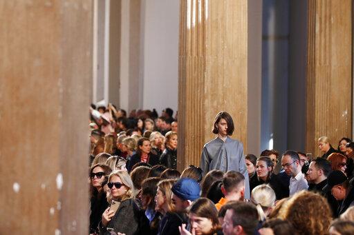 Milan Fashion Week carries on amid virus, economic concern