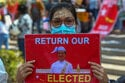 Pro-military marchers in Myanmar attack anti-coup protesters