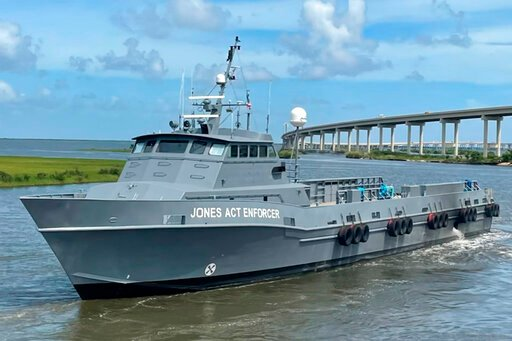 Ship hunts foreign ships doing work reserved for US crews