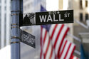 Stocks down, yields up as Fed discusses dialing back support