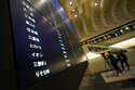 Stocks edge off record highs as investors gauge outlook