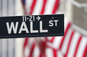 Stocks fall as Wall Street puts quiet stamp on rocking month
