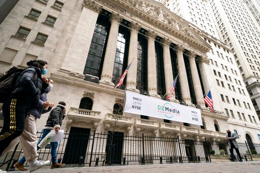 Stocks on Wall Street waver, clinging to gains for the week
