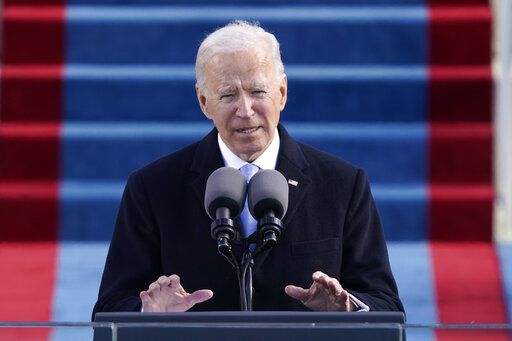 The Latest: Biden boosts US response to COVID-19 pandemic