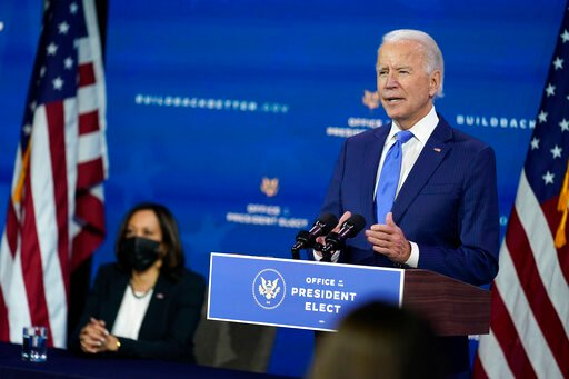 The Latest: Biden: I won't immediately lift China tariffs