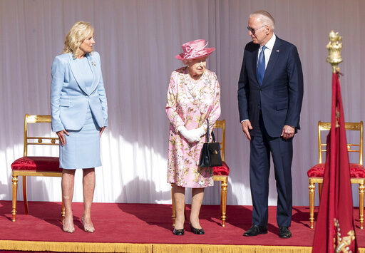 The Latest: Biden invites queen, 95, to stay at White House