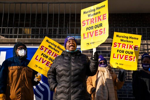 The Latest: Chicago-area nursing home workers walk off job