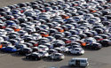 The Latest: EU says US car tariffs would break trade rules