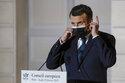 The Latest: France's Macron confident EU to agree on travel