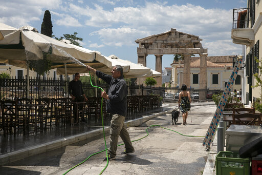 The Latest: Greece to open tourism industry on May 15
