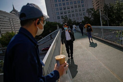 The Latest: Joint venture aims to make 1B doses for Chinese