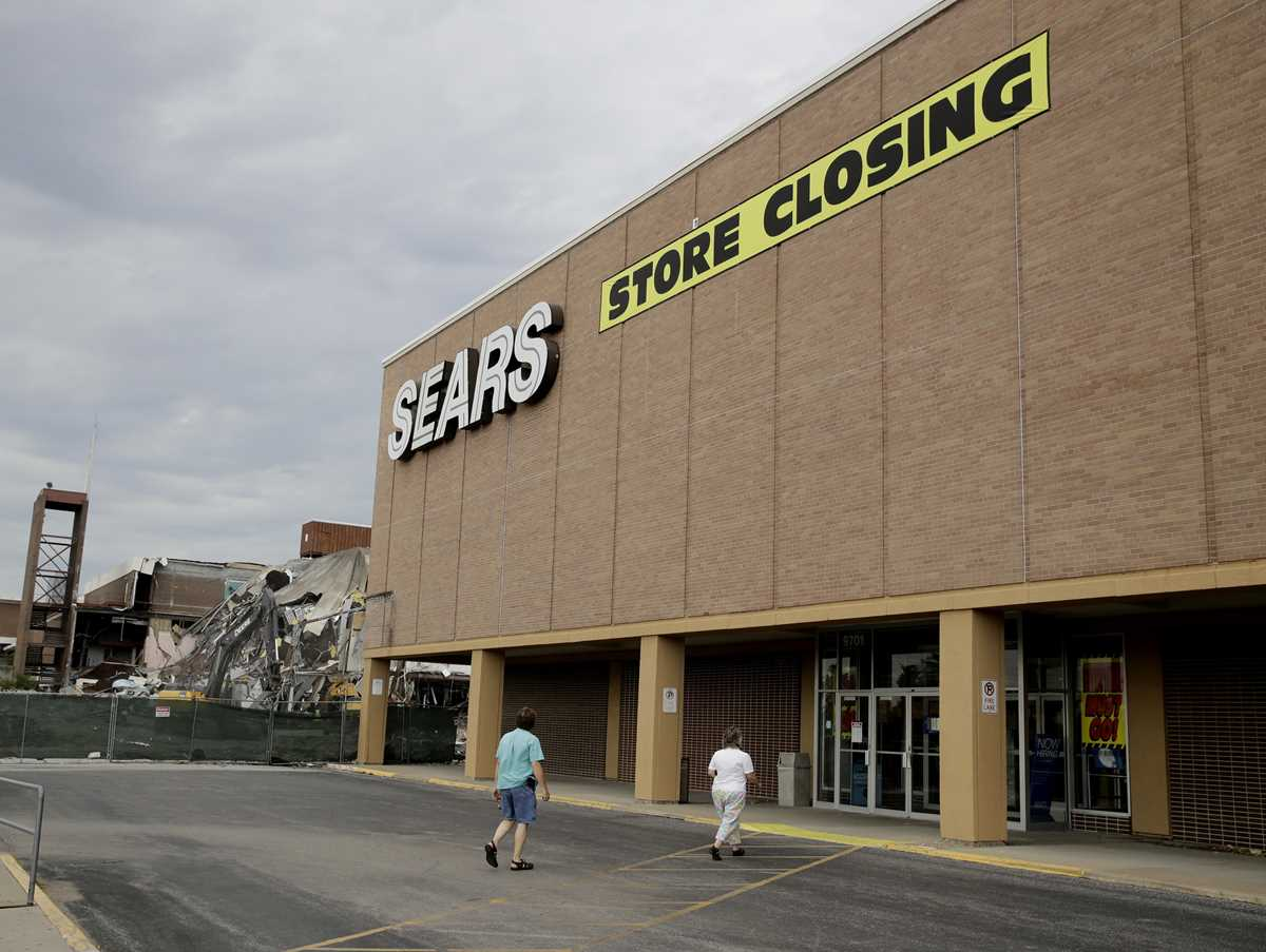 The Latest: Sears, inundated by debt, seeks protection