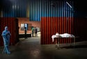 The Latest: Spain: Prevention, vaccines keep virus in check
