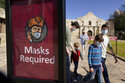 The Latest: Study finds masks, dining rules help curb spread