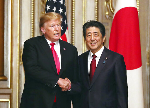 The Latest: Trump enjoys 6-course dinner at Japan palace
