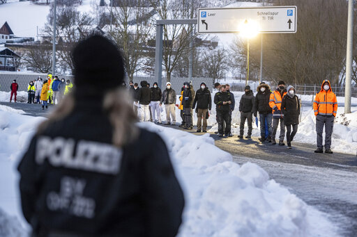 The Latest: Virus rules make for long lines at German border