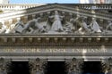 US indexes wobble in muted trading, hold near record highs