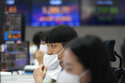 World shares mostly higher ahead of US price data