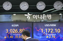 World shares retreat, chilled by decline on Wall Street